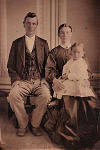 A. W. Bradley, and his wife. Francis Empson Bradley, and their daughter. Enola. circa 1870